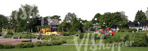 cut out view on a park with a house and playground