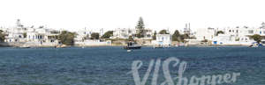 cut out background with white houses by the sea