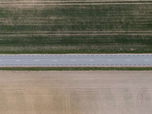 road between fields seen from above