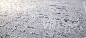 snow-covered pavement with footprints