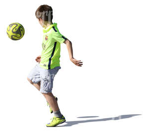 young boy playing with a ball
