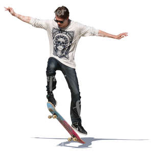 young man performing a stunt on his skateboard