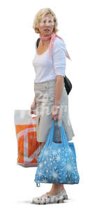 woman standing with two bags in her hands