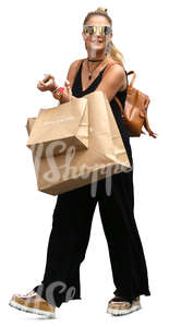 woman with two big shopping bags walking and smiling