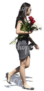 young asian woman with a flower bouquet walking