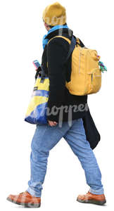 man with many colorful bags walking