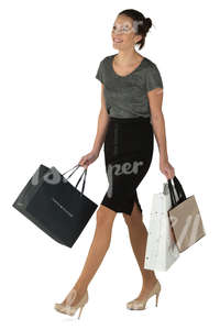 young smiling woman walking with many shopping bags
