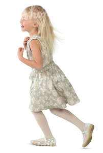 young blonde girl in a party dress running around merrily