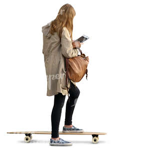 young woman standing on a skateboard and looking at ipad