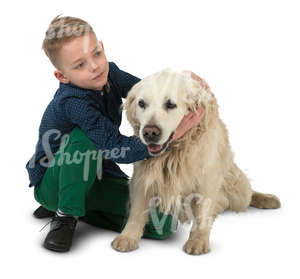 young boy sitting on the floor with his dog