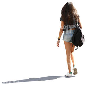 backlit young woman with long hair walking down the street
