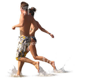 man and woman running hand in hand into water