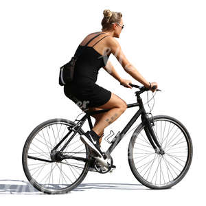 woman in a black dress riding a bicycle