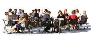 street cafe scene with many groups of people sitting and talking