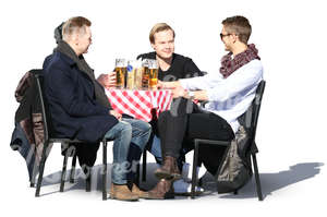 four young men sitting in a cafe and drinking beer