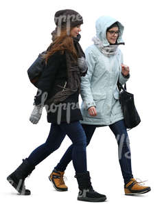 two teenage girls in winter coats walking side by side