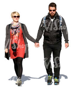 couple walking hand in hand on a sunny spring day