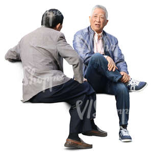 two older asian men sitting and talking