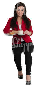woman sitting at a cafe table and drinking coffee