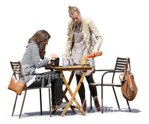 two women hanging in a cafe and eating and drinking
