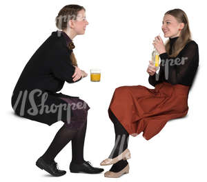 two girls sitting in a cafe and talking