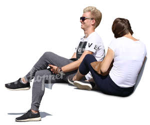 young man and woman sitting on a bench and laughing