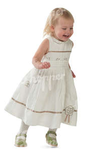 little girl in a white dress running and laughing