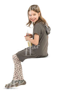 young girl sitting in a cafe and drinking lemonade