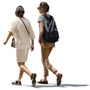 two backlit women walking side by side