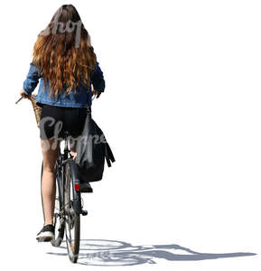 woman with long hair riding a bicycle