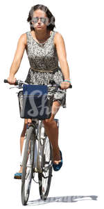 woman in a summer dress riding a bicycle