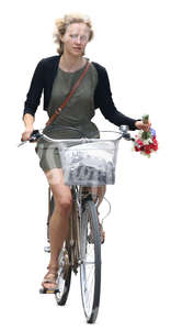 woman riding a bicycle with flowers in her hand