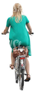 woman in a green dress riding a bicycle