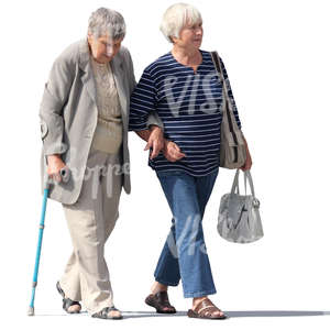 two elderly ladies walking arm in arm