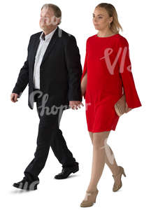 man and woman in formal clothing walking hand in hand