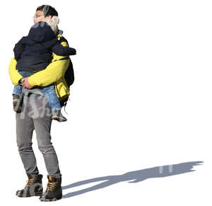 asian man standing and holding his daughter in his arms