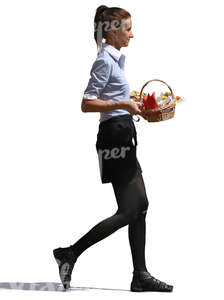 waitress walking and carrying a bread basket and plates