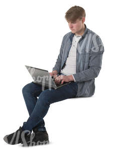 young man sitting with a laptopn on his knees