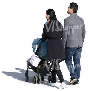 asian couple with a baby stroller walking on a sunny day