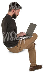 man sitting and working with a laptop
