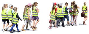 group of children wearing reflector vests walking
