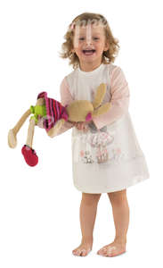 little girl in a pink dress playing with her toy rabbit