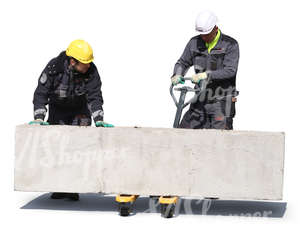 two workers lifting a large concrete block