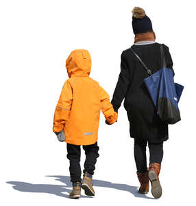 mother and child in winter clothes walking hand in hand