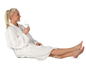 woman in a white bathrobe sitting in a spa