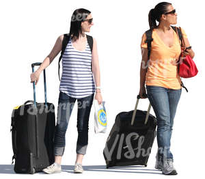 two women with big suitcases walking on the street