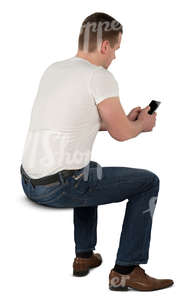man sitting at the desk and texting