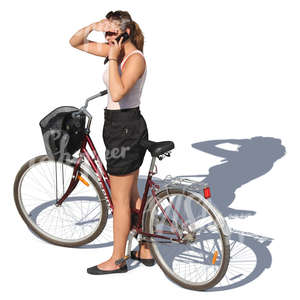 woman with a bicycle talking on a phone