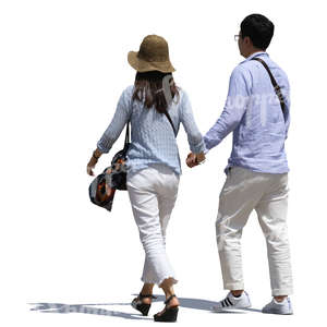 asian couple walking hand in hand on a sunny street