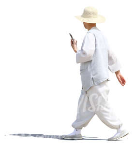 asian man wearing white blouse and trousers walking
